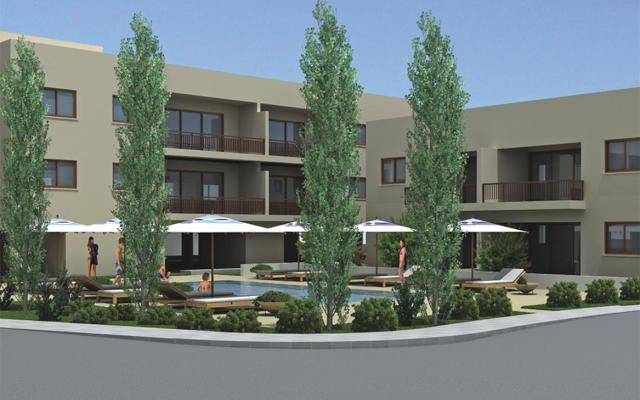 housing block with apartments and communal areas with swimming pools and gardens