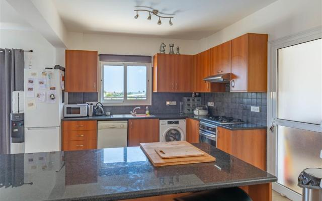 Spacious kitchen in property for sale