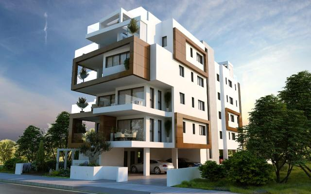 Day view of building with apartments for sale