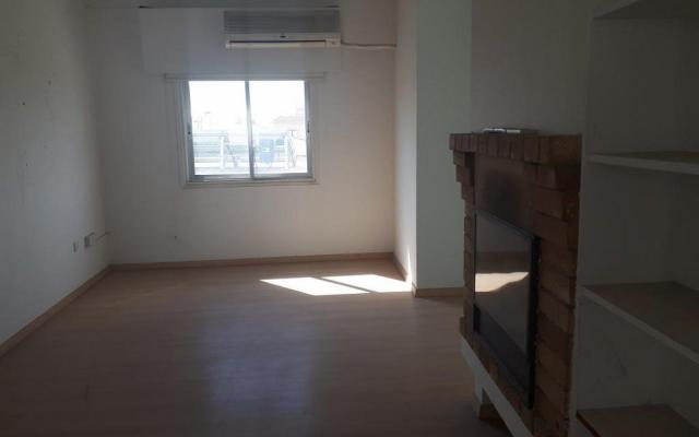 Living Area with fireplace in apartment in Sotiros