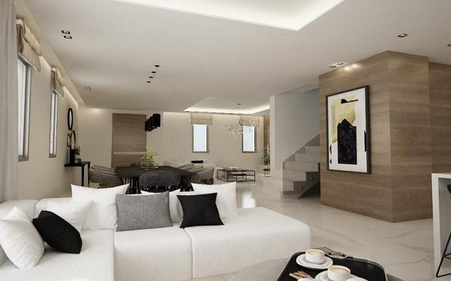 open plan lounge dining area  with a luxury modern kitchen.
