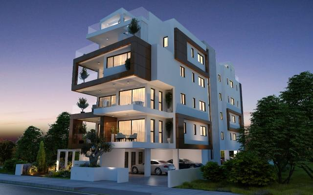 Night time view of building with apartments for sale