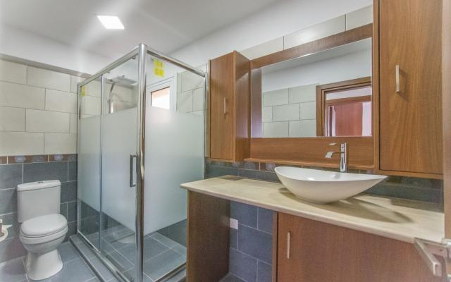 Bathroom with shower in flat for sale in Derynia